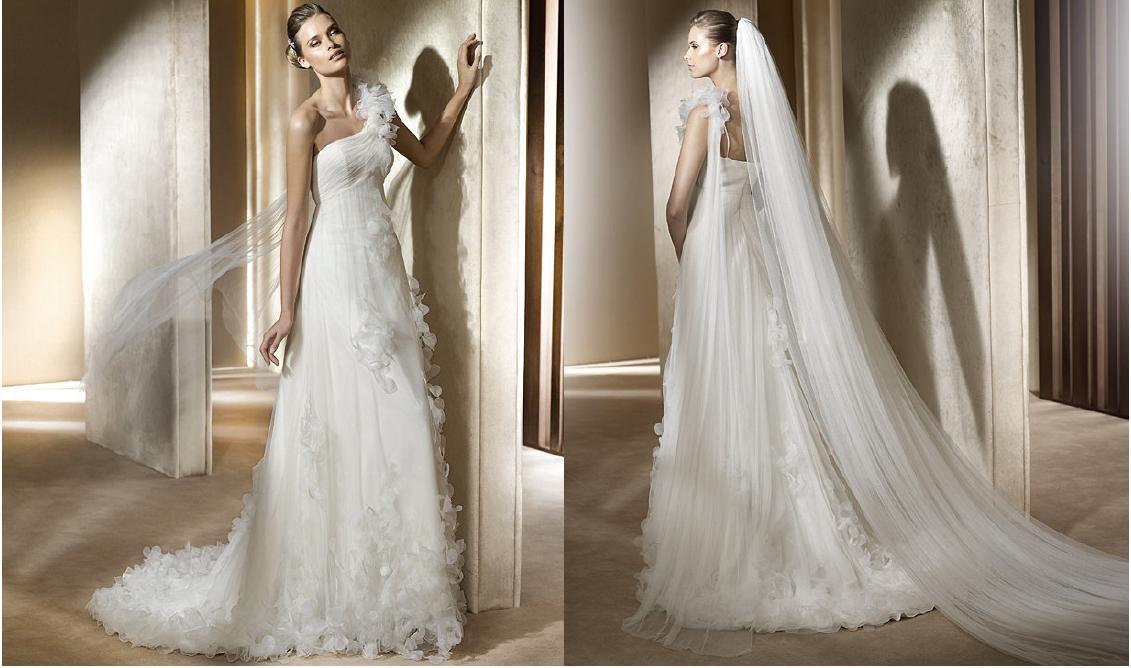 840d1c9eeb Suknia ślubna Tirso od Manuel Mota kolor  złamana biel biel rozmiar  34-36